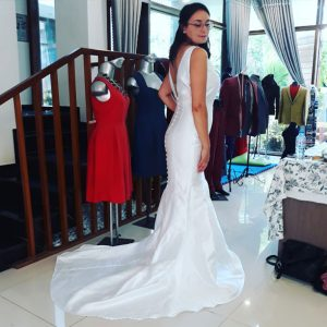 Wedding dress with full button cover fabric
